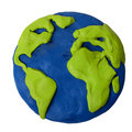 Plasticine earth planet on a white background Royalty Free Stock Photo