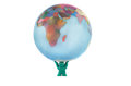 Plasticine man holding globe terrestrial isolated on white Royalty Free Stock Image
