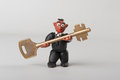Plasticine man with key Royalty Free Stock Photo