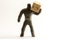 Plasticine man with a wooden cube Royalty Free Stock Images