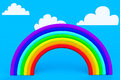 Plasticine rainbow with white clouds on a blue sky Royalty Free Stock Photos