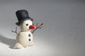 Plasticine snowman handmade on snow Stock Photos