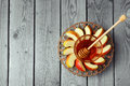 Plate with apple and honey for Jewish Holiday Rosh Hashana (New Year). View from above with copy space Royalty Free Stock Photo