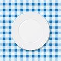 Plate on blue tablecloth Stock Images