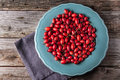 Plate of briar top view on turquoise with fresh berries on old wooden table Royalty Free Stock Photo
