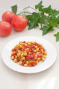 Plate with chickpeas and tomatoes salad Stock Photography