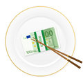 Plate chopsticks and one hundred euro pack banknotes on a white background Royalty Free Stock Photos