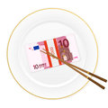 Plate chopsticks and ten euro pack Stock Photos