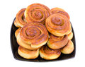Plate with cinnamon buns Royalty Free Stock Photography
