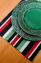 Plate and colorful table cloth Royalty Free Stock Photos