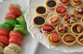Plate colorful tasty desserts Stock Photo
