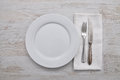Plate, cutlery and cloth on wood Royalty Free Stock Photo