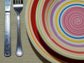 Plate and cutlery plates on a tablecloth Royalty Free Stock Photos
