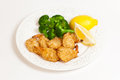 Plate deep fried coconut shrimps broccoli Stock Photo