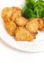 Plate deep fried coconut shrimps broccoli Royalty Free Stock Photography
