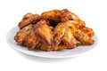 Plate of delicious barbecue chicken wings on white Royalty Free Stock Image
