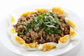 Plate of egyptian foul with eggs or ful medames on a garneshed slices hard boiled egg and flat leaf parsley foulm made from fava Royalty Free Stock Image