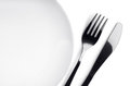 Plate, fork and knife Royalty Free Stock Photo