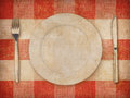 Plate fork knife over grunge tablecloth background and Stock Photos