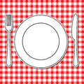 Plate fork and knife on tablecloth Stock Photo