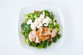 Plate of fresh chopped grilled chicken salad on a white background Stock Photo