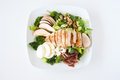 Plate of fresh chopped grilled chicken salad on a white background Stock Images