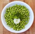 Plate of fresh cut green peas Royalty Free Stock Photo