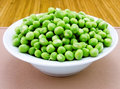 Plate of fresh green peas Stock Photography