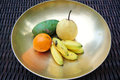 Plate with fresh mixed fruits on table Stock Images