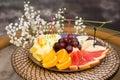 Plate with fresh sliced fruits banana grapes grapefruit orange restaurant Royalty Free Stock Image