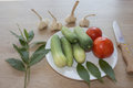 Plate with fresh vegetables on table. Cucumber. Fresh, raw vegetables on the table