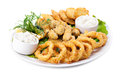 Plate of fried in batter squid and mussels with sauce Stock Image