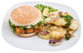 Plate with fried Potatoes and a Fish Burger Royalty Free Stock Photo