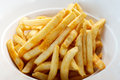 A plate of fries yellow crispy french in the white Stock Photo
