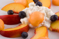 Plate of fruit and cottage cheese Stock Photography