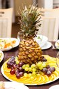 Plate with fruit dessert on holiday table Stock Images