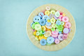 Plate full of pastel colored buttons Stock Photo