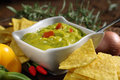 Plate of guacamole with tortillas dish pepper and spicy Stock Image