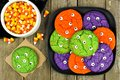 Plate of Halloween monster eyeball cookies with candy corn Royalty Free Stock Photo