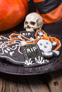 Plate of halloween sugar cookies a full assorted chocolate including gravestones bats ghosts and pumpkins for a party Royalty Free Stock Images