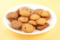 Plate of home bakes raisin cookies selective focus photograph in white background Royalty Free Stock Photos