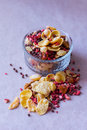 Plate of homemade muesli with cornflakes, freeze dried strawberry, walnuts, chocolate balls, pumpkin seeds Royalty Free Stock Photo