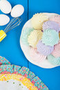 Plate homemade pastel colored meringue cookies Stock Images