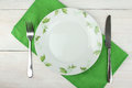 Plate with the image of flowers, a knife and fork Royalty Free Stock Photo