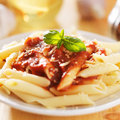 Plate of italian penne pasta in tomato sauce Royalty Free Stock Image