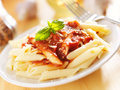Plate of italian penne pasta in tomato sauce Stock Image