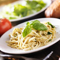 Plate of italian spaghetti with pesto sauce close up photo a Royalty Free Stock Photo
