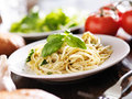 Plate of italian spaghetti with pesto sauce shot close up selective focus Royalty Free Stock Photography