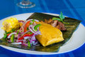 Plate of the latinamerican tamal with garnishing tamales Royalty Free Stock Photos
