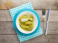 Plate with measure tape, knife and fork. Diet food Royalty Free Stock Photo